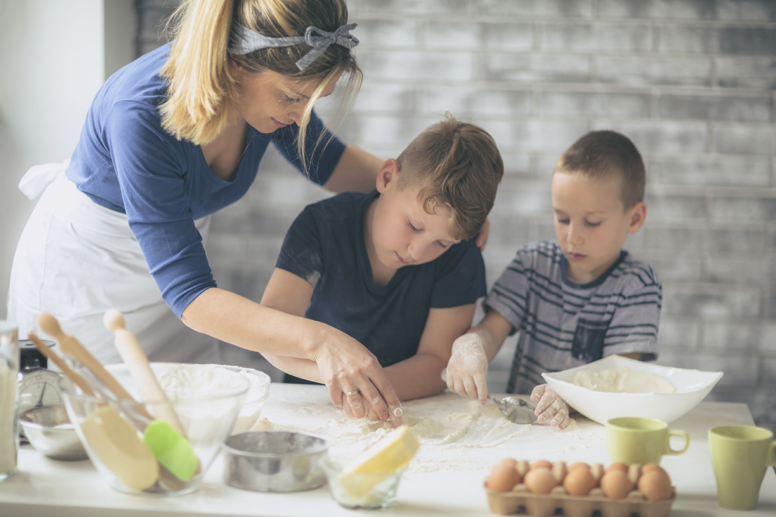 Mother baking with her two sons