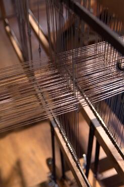 A loom weaving a blanket