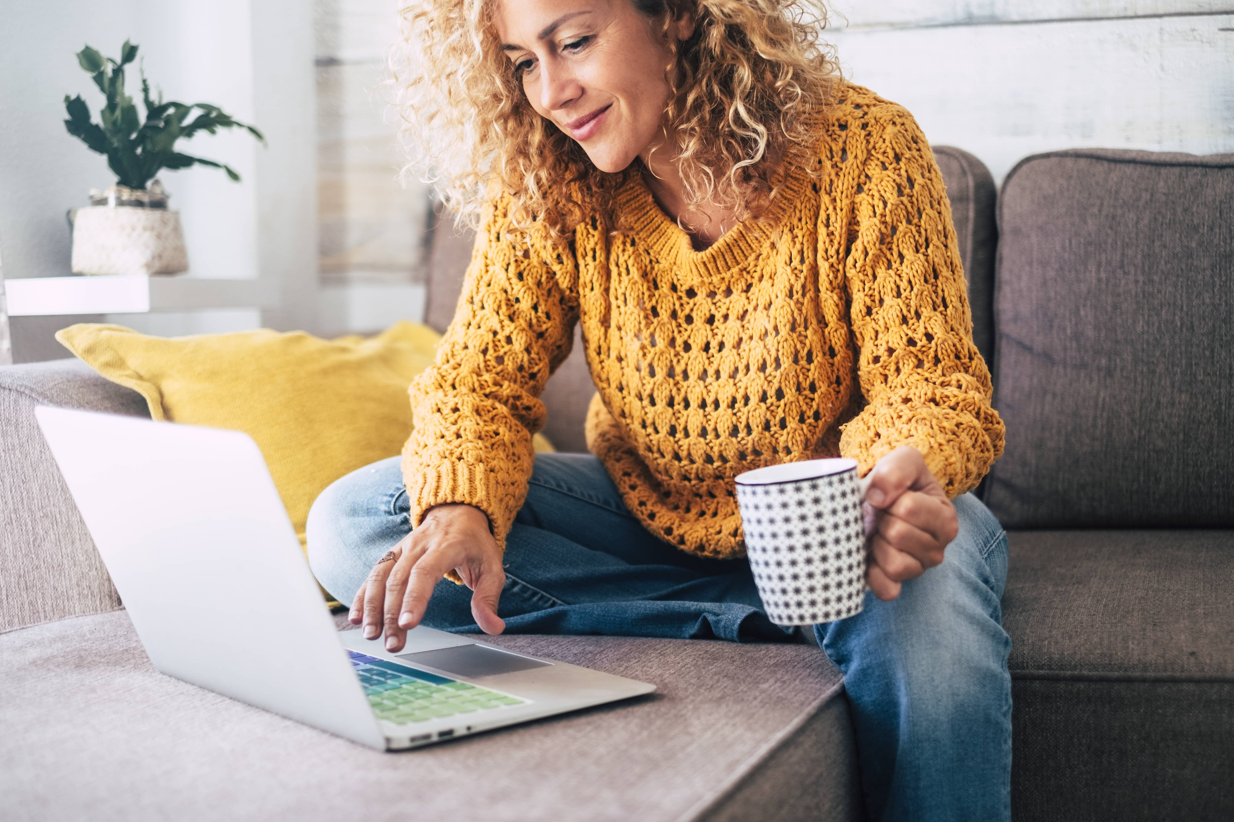 Woman procrastinating by surfing the internet