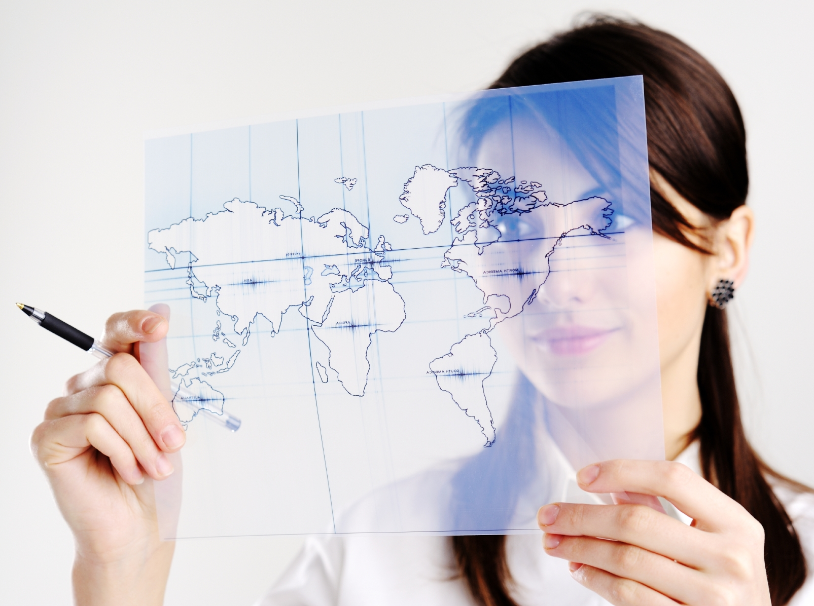 Woman looking a map symbolizing a person's map of reality