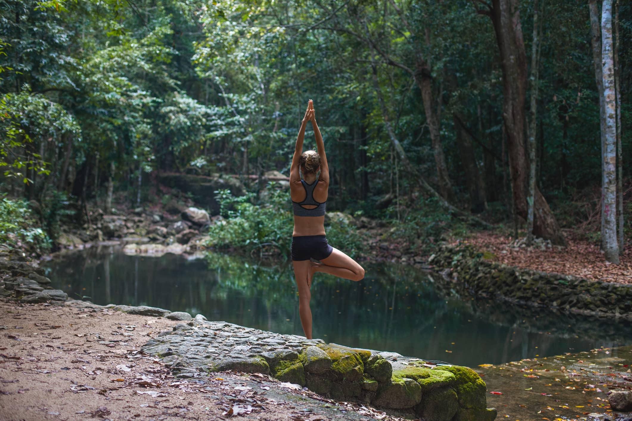 Woman doing a yoga tree pose