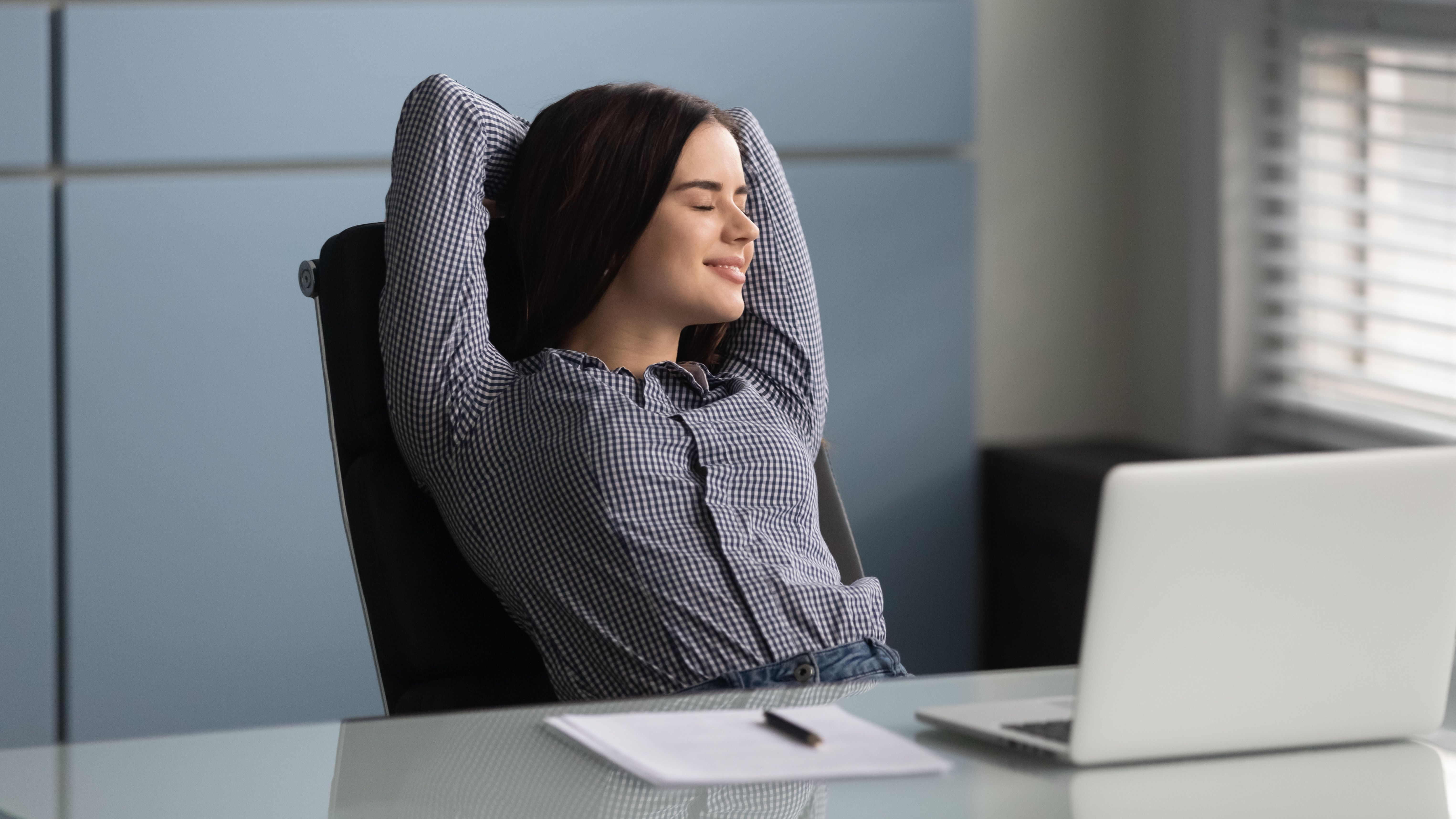 A young woman relaxing while doing a visualization