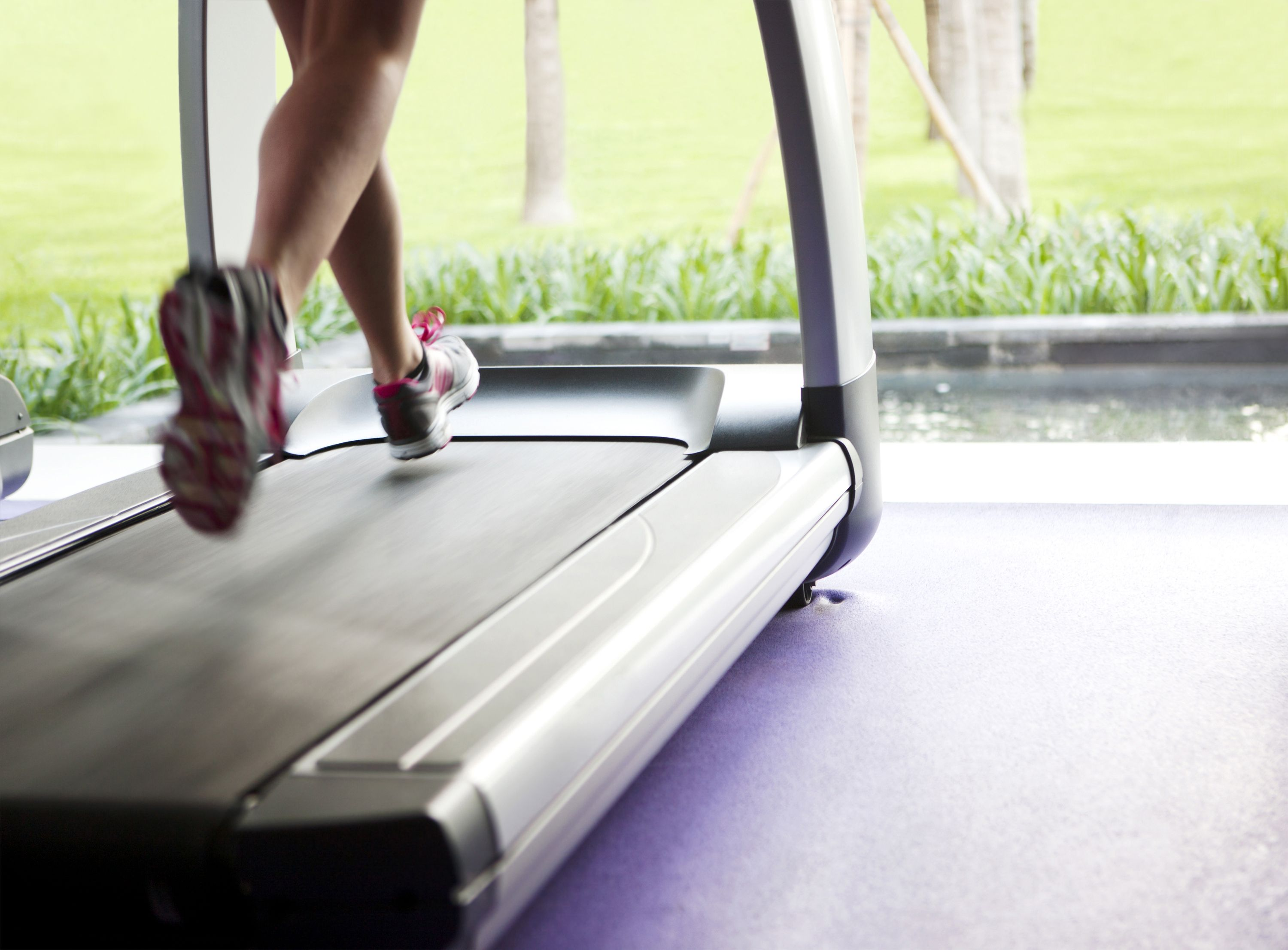 Woman running on treadmill developing the habit of exercise