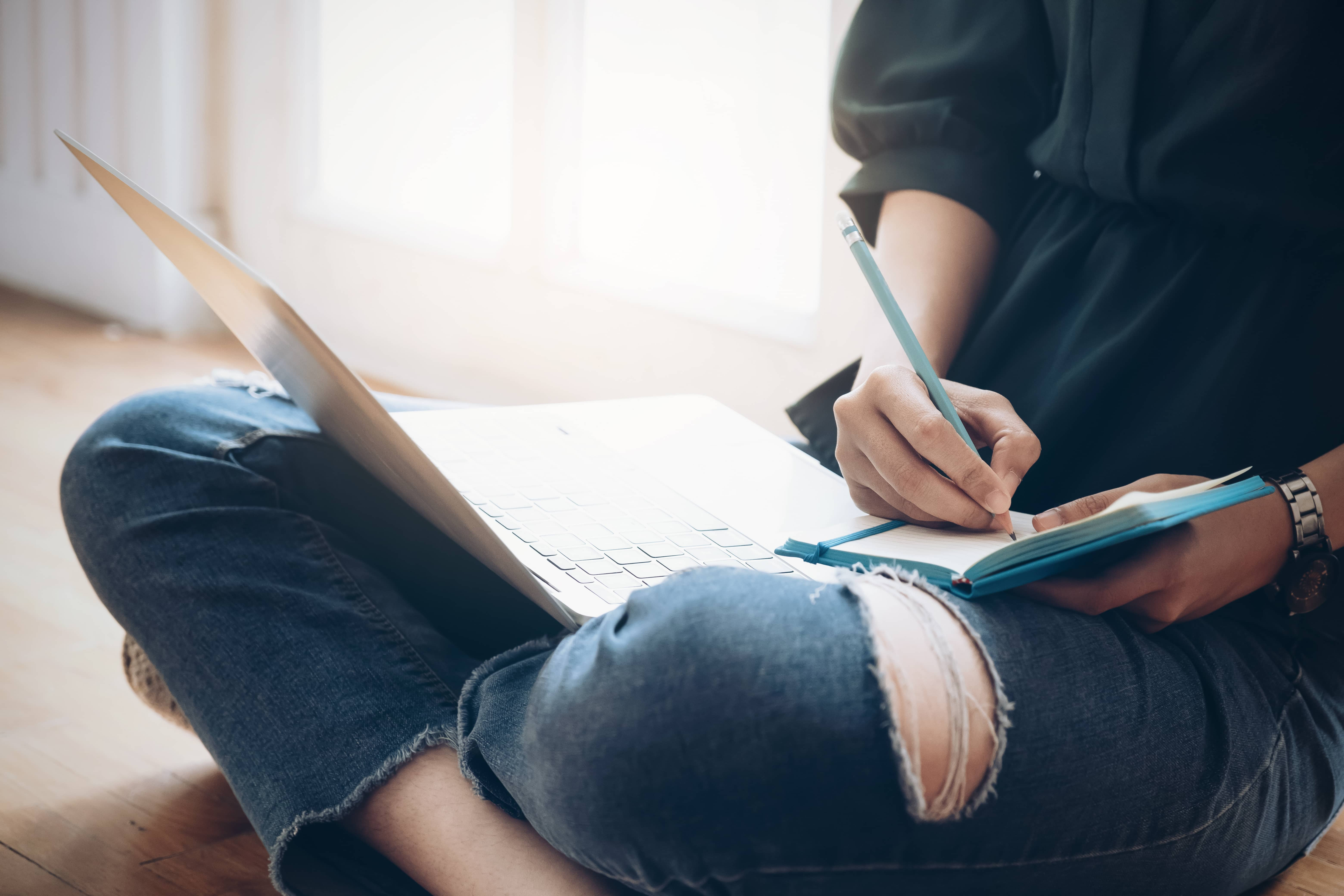 Woman journaling for greater self-awareness