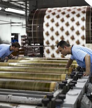 Two textile manufacturers checking alignment