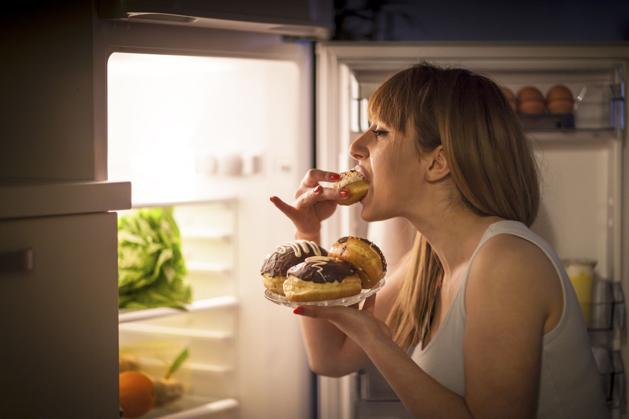 Woman eating away unpleasant emotions