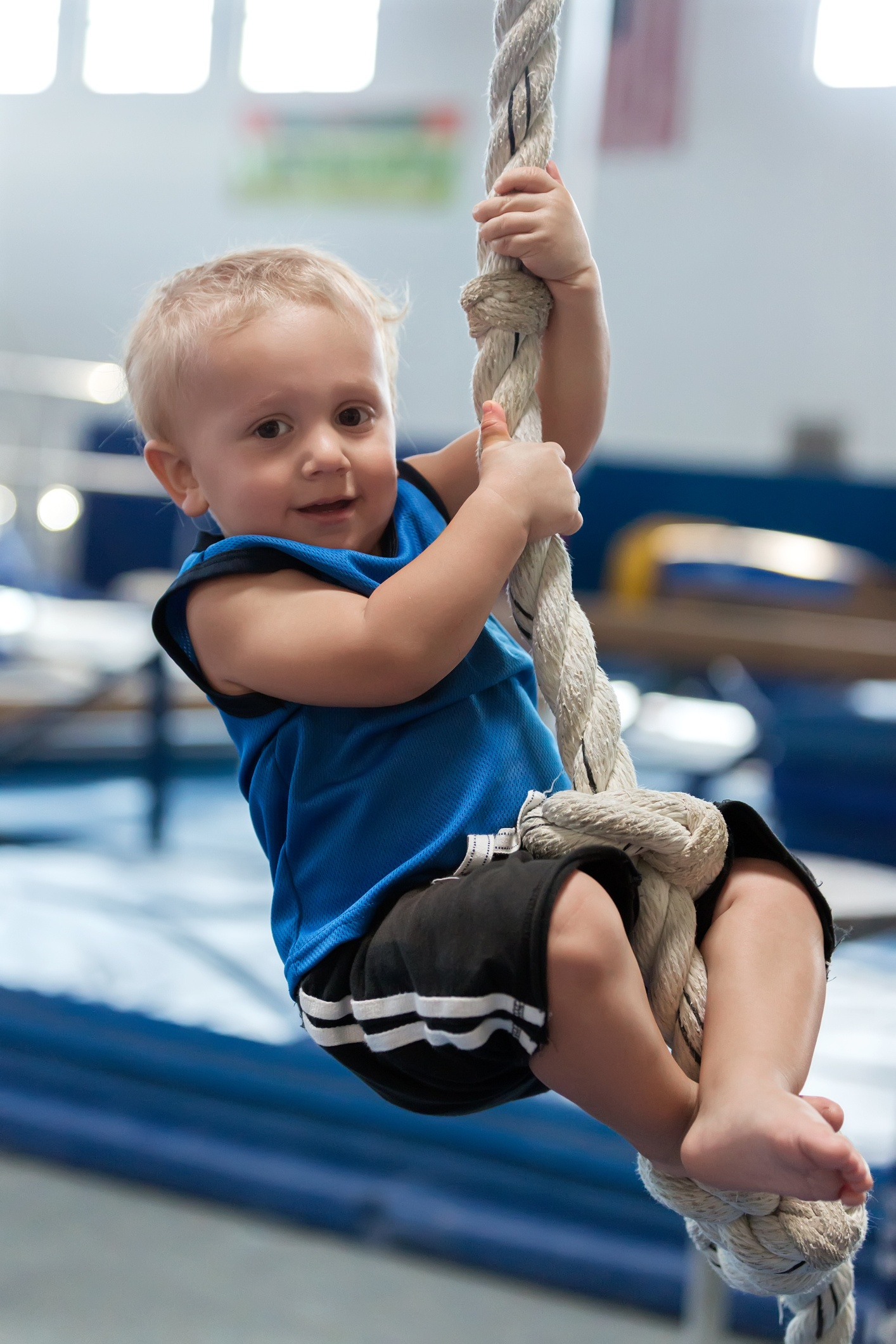 Toddler climbing on a rope