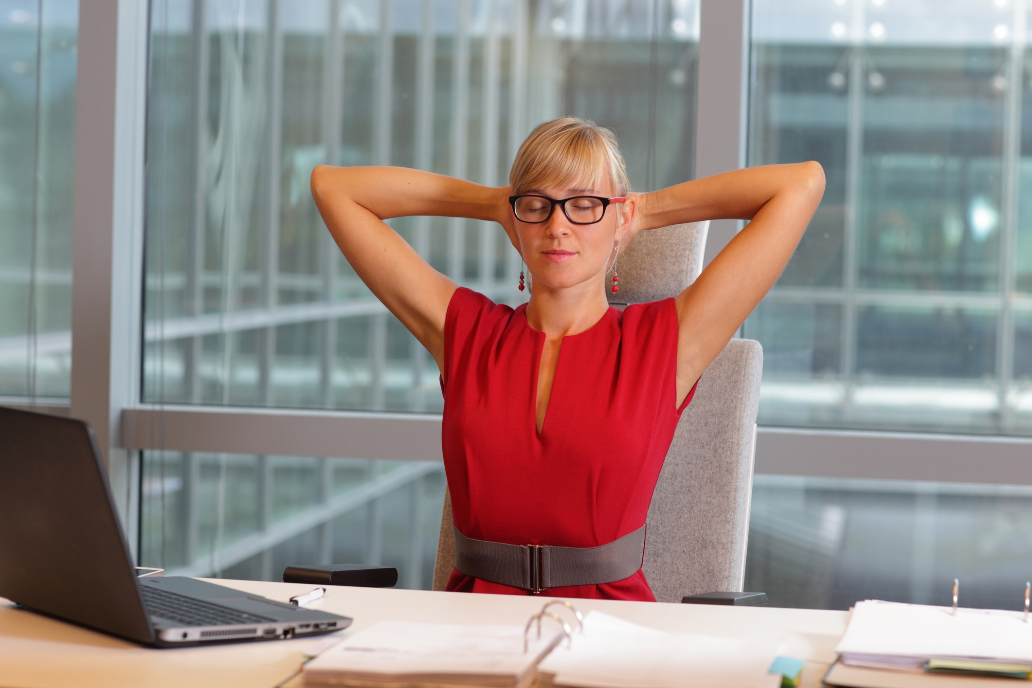 caucasian-business-woman-in-eyeglasses-relaxing-neck,stretching-arms-488156170_2125x1416.jpeg