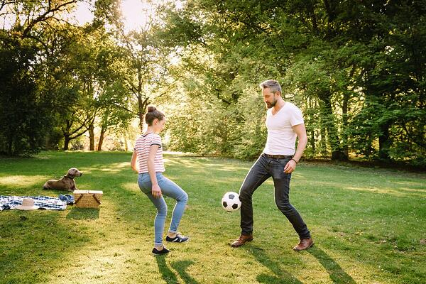 father-and-teenage-daughter-playing-soccer-in-park-685964984_1258x838-compressor