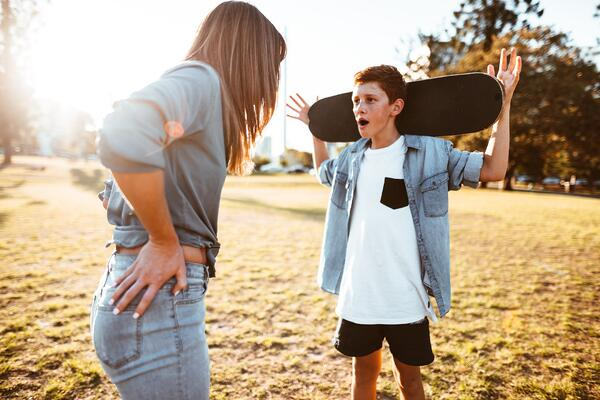 Teenage boy in argument with his mom