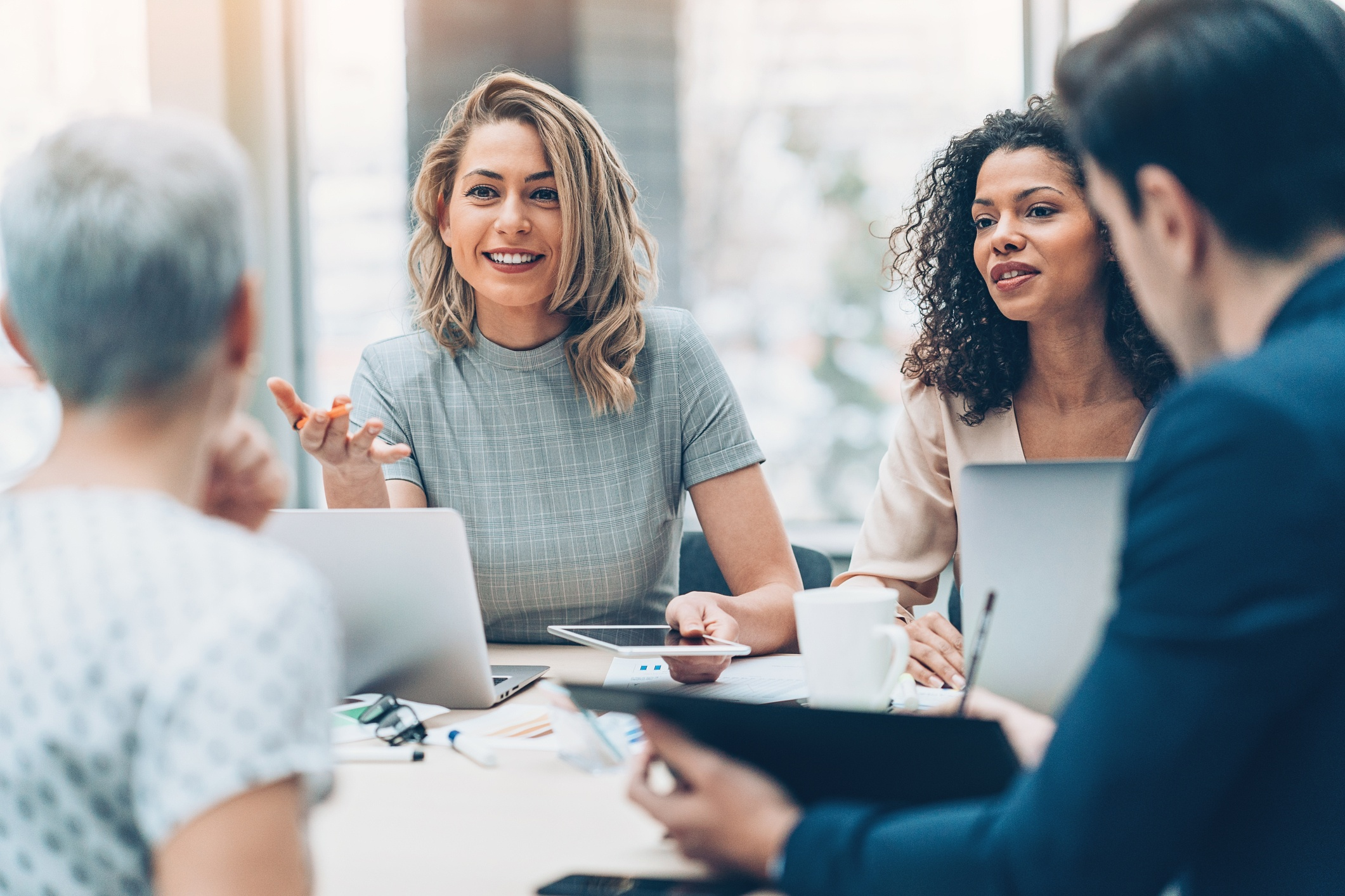 Business team interacting with cognitive empathy