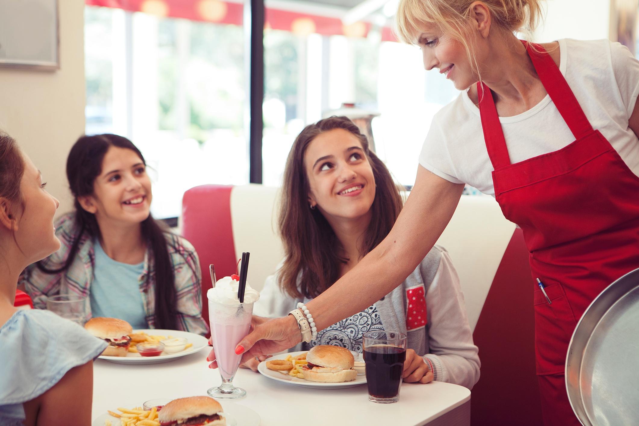 Waitress serves a family