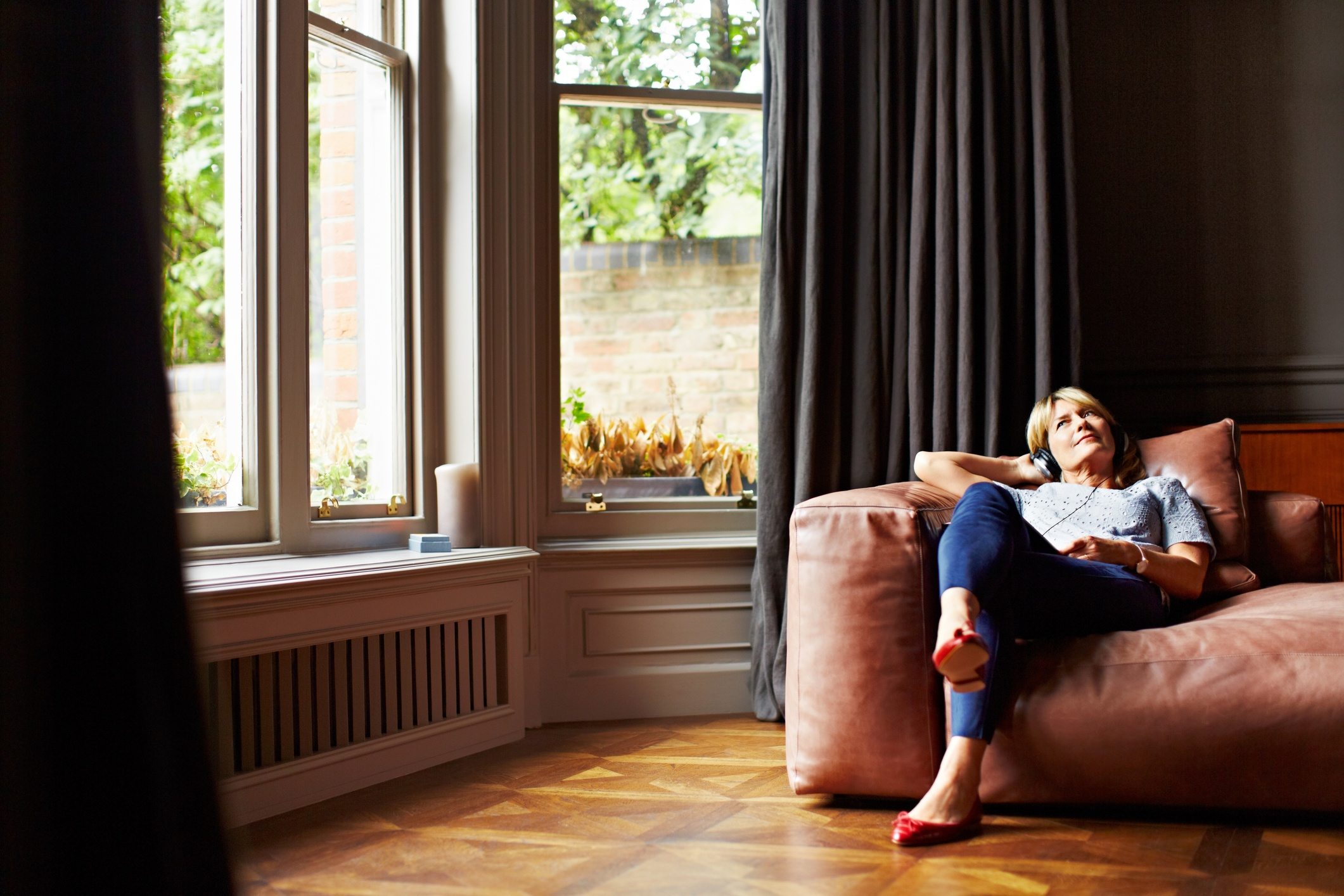 Woman enjoying relaxation and reveling in self acceptance