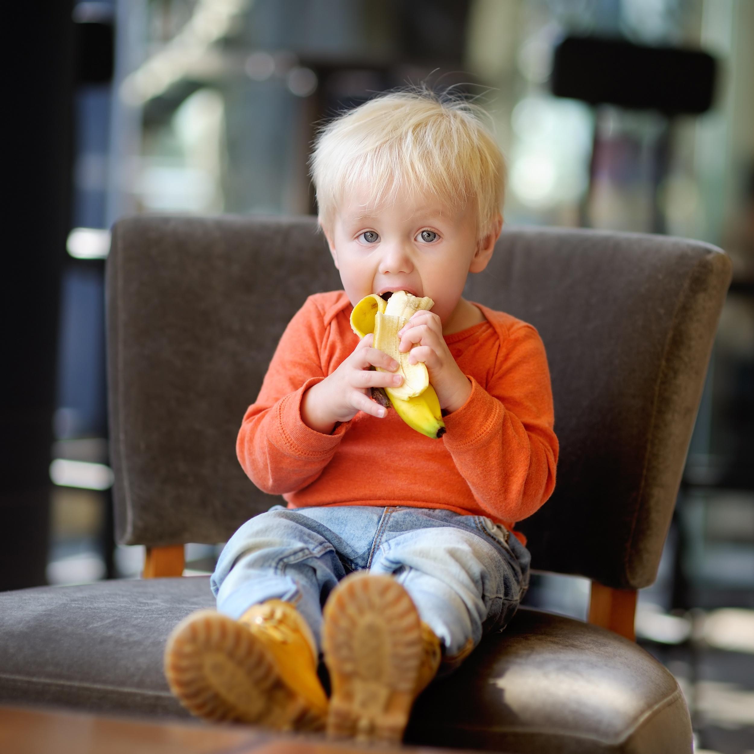 Toddler-boy-eating-banana-508039050_2500x2500.jpeg