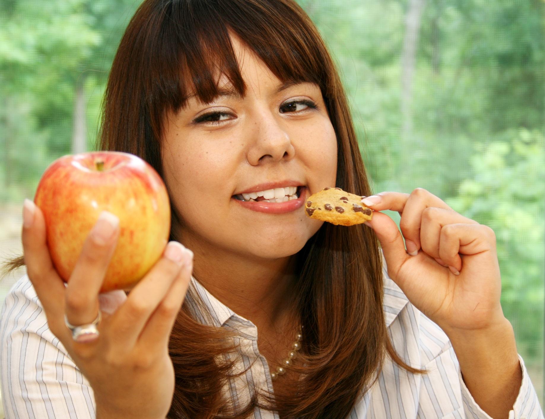 Young-Hispanic-Woman-Making-A-Food-Choice-CROPPED.jpg